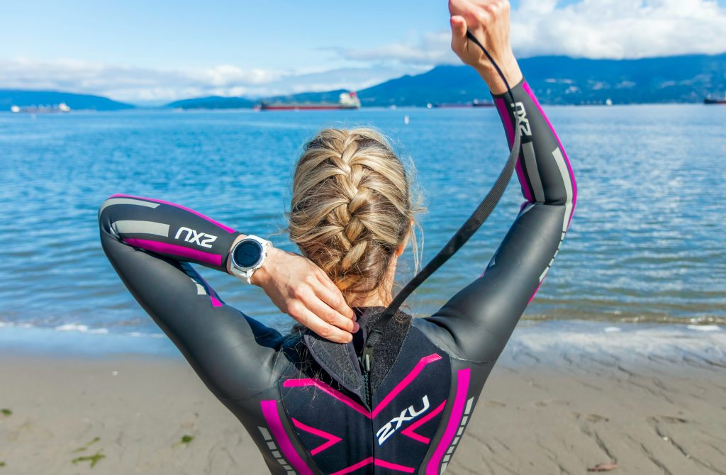 woman in wetsuit getting ready for a swimming workout
